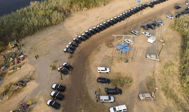 Texas Forms Miles-Long Border Barrier from State Troopers and National Guard Vehicles